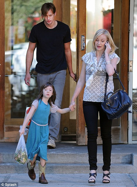 Hand in hand: His on-screen daughter with Scottish actress Joanna Vanderham, who was also on set