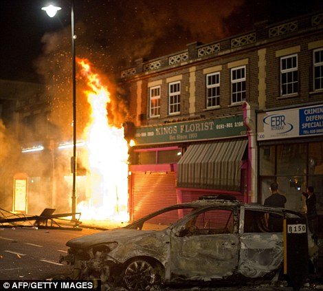 Two police cars were on Saturday set ablaze and windows smashed in the businesses in Tottenham
