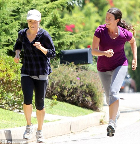 Moral support: Alanis was joined by a friend on her work-out