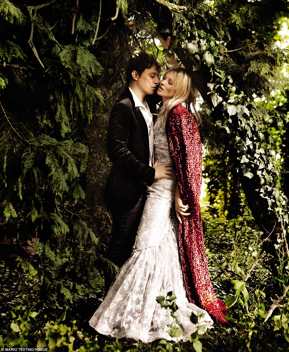 Stunning shots: Kate Moss and Jamie Hince pose up together in intimate picture taken by their official wedding photographer Mario Testino, which appear in American Vogue's September issue