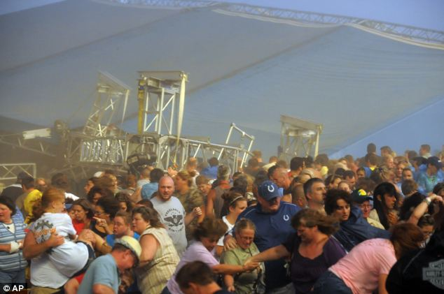 Panic: Fans waiting to see Sugarland run away after high winds blew the stage over