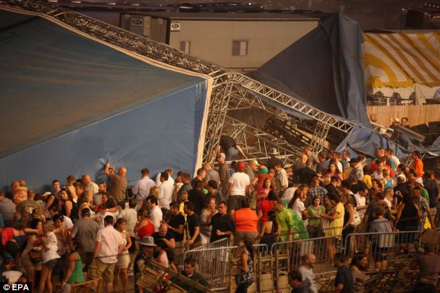 Devastation: The National Weather Service reports portions of the stage were blown into the grandstands