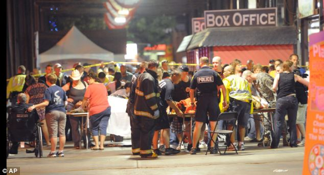 Emergency: Family members tend to their injured relatives as Indianapolis Fire Department personnel and paramedics tend to the victims