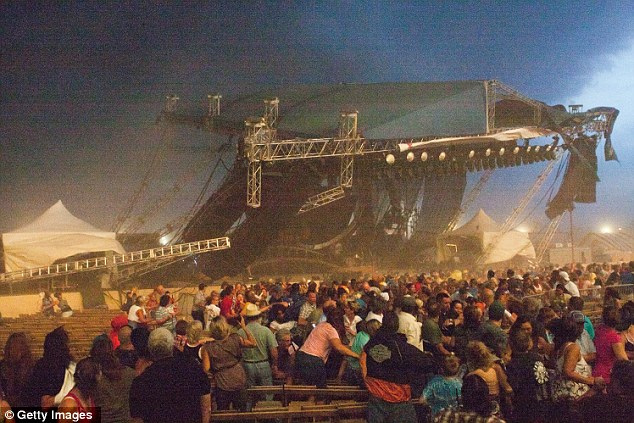 Horror: The moment strong winds caused the stage rigging for the outdoor concert to collapse at the fairground in Indianapolis