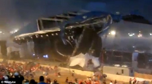 Ominous: Fans try desperately to flee as the stage suddenly crumbles above them