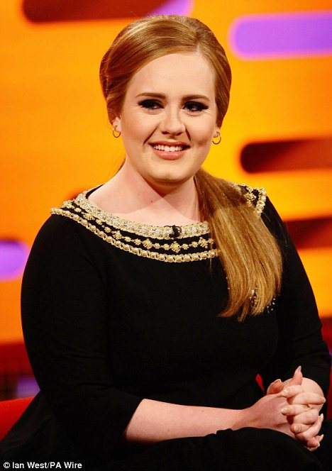Easy to please: Adele admits all she looks for in a man is someone who makes her laugh
