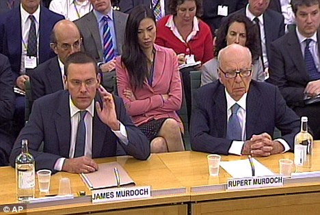 Giving evidence: James Murdoch and his father Rupert Murdoch giving evidence to the Culture, Media and Sport Select Committee on the NOTW in Portcullis House in central London in July