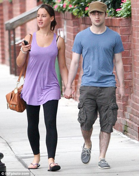 Casual couple: The pair were dressed in a relaxed manner with Daniel in a simple T-shirt and short combo while his girlfriend opted for leggings and a lilac vest