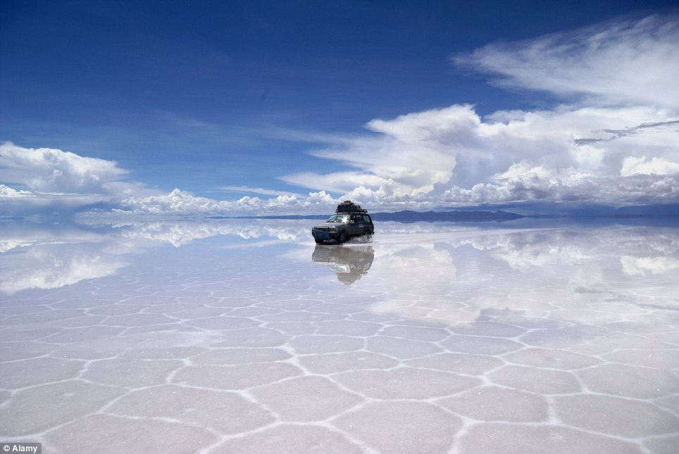 Stunning: The salt flats themselves are 3,600m above sea level in the Andes - making it almost possible, it seems, to reach up and touch the clouds from the ground