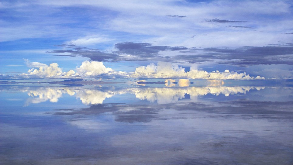 Mirror image: It is hard to tell where the lakes end and the clouds begin in this beautiful image