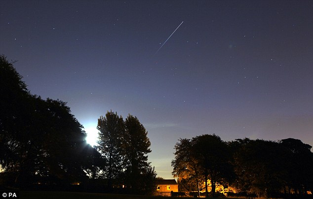 Trailblazer: The International Space Station is seen clearly the the top of the photo orbiting the earth over Woolton in Liverpool