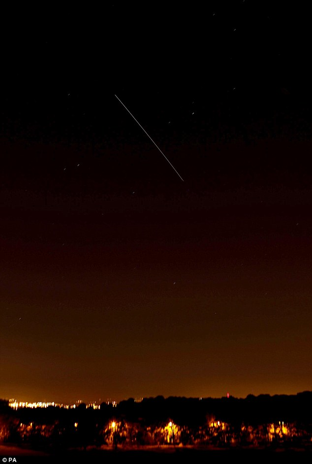 High up in the night sky the object has a white tail making it easy to spot from Britain