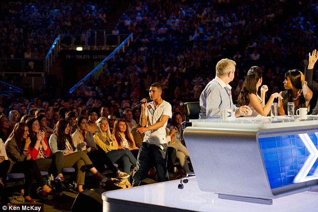 Abuse: George storms off stage and goes around the back of the judging panel shouting insults at Tulisa