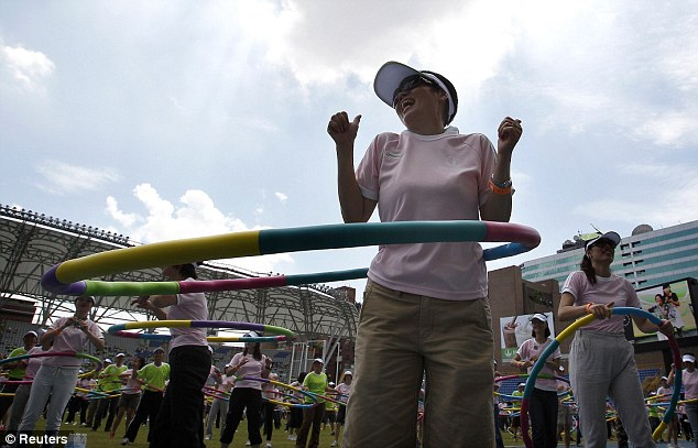 In a spin: A woman gets into the swing of things during the mass hula