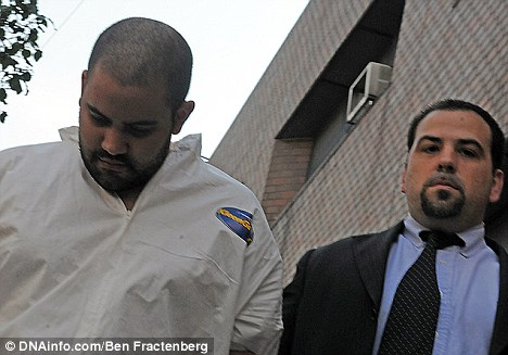 Charged: Officer Michael Pena is led from the 34th Precinct stationhouse in Manhattan after his arrest