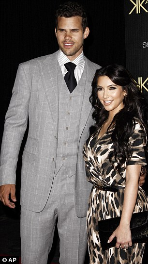 The happy couple: Kim and NBA star Kris pictured on Wednesday this week at the launch party for the Kardashian Kollection