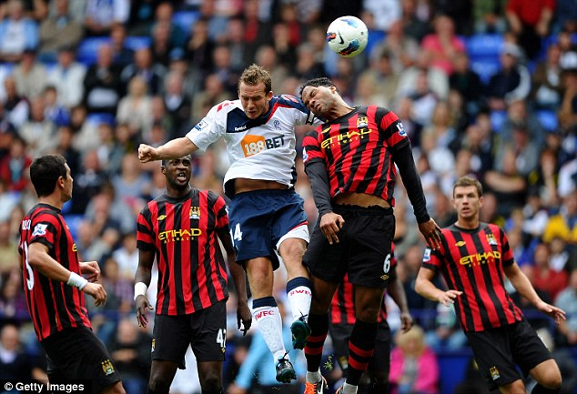 Consolation: Kevin Davies (centre) pulls a goal back for Bolton but it proved to be too little, too late