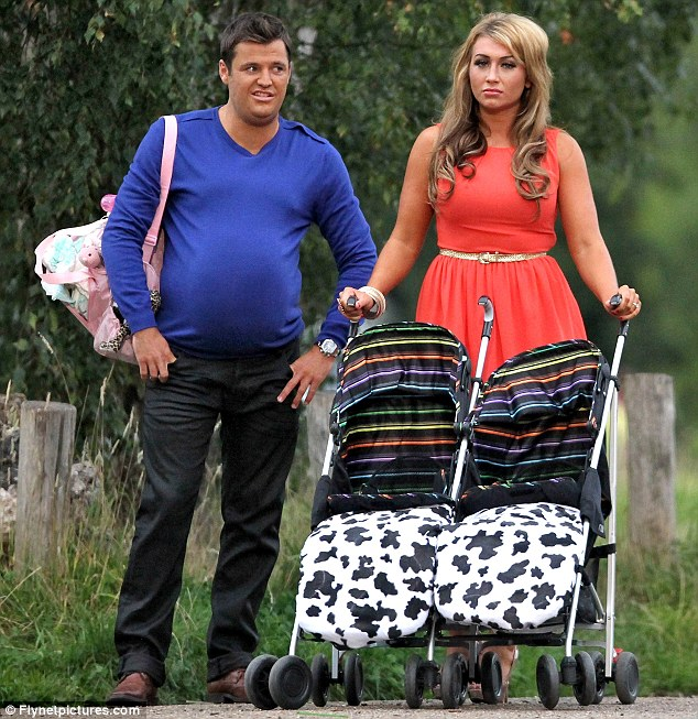 A vision of the future? Mark Wright appears to have piled on the pounds and aged somewhat as he films an advert for the third series of The Only Way Is Essex with fiancée Lauren Goodger