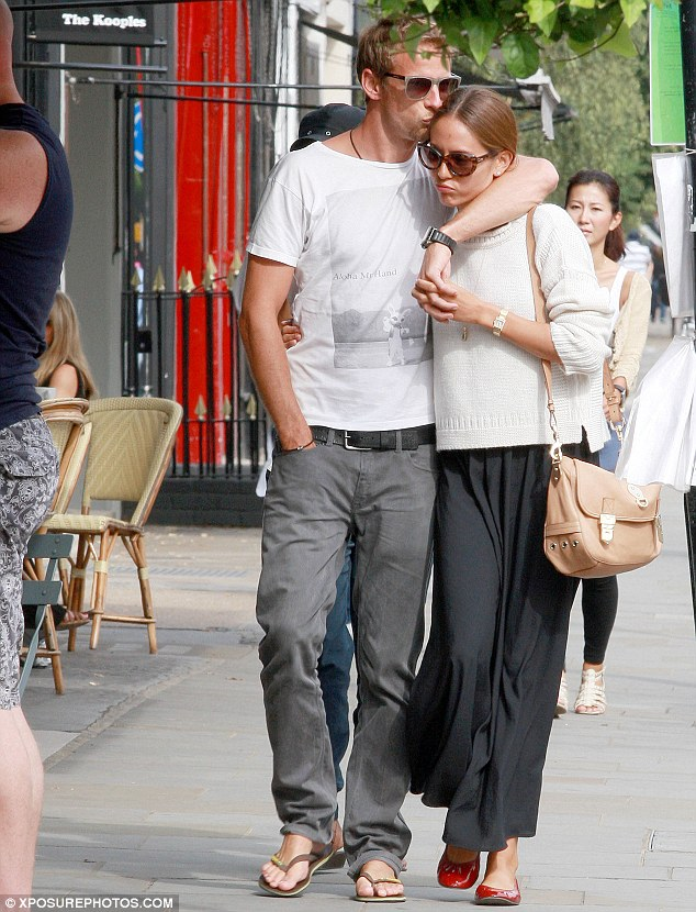 Affectionate: Button and Michibata lavish attention on each other as they walk down the street