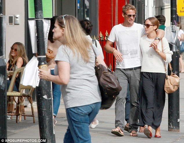 It's a small world: Jenson Button and his girlfriend Jessica Michibata walk past a West London cafe, apparently unaware his ex-girlfriend Florence Brudenell-Bruce is seated outside (far left)