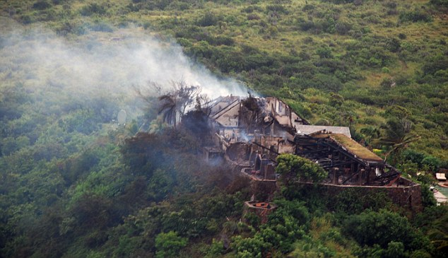 Paradise lost: All that's left of Sir Richard Branson's luxury home is a smouldering ruin