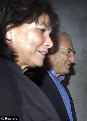 Dominique Strauss-Kahn leaves L'Artusi restaurant with his wife Anne Sinclair