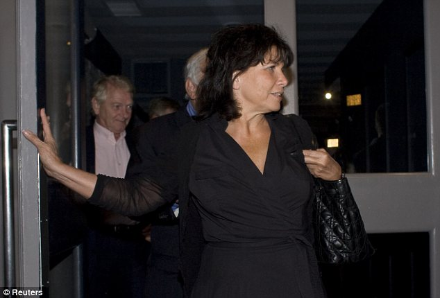 The former IMF chief's wife Anne Sinclair leaves the restaurant after their celebratory meal