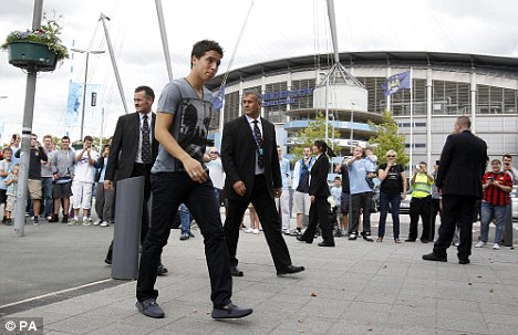 Here he comes: Samir Nasri arrives at the Etihad Stadium