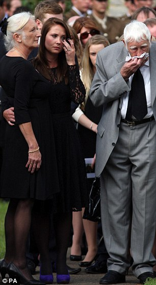 Tears: Amy Tinley wipes a tear away with a finger