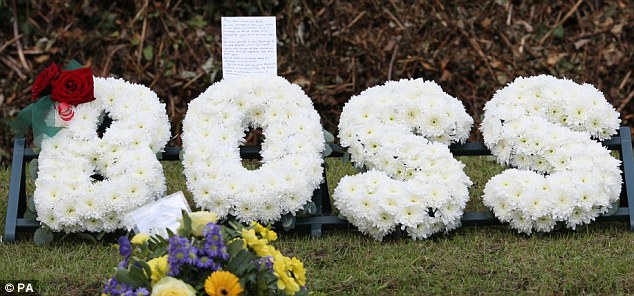 Floral tribute: This flower arrangement in white chrysanthemums from The Rifles was laid in front of the Lieutenant's coffin