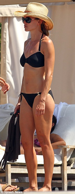 Toned, tanned and trim: The 37-year-old actress owes her incredible figure to punishing daily workout sessions at the gym