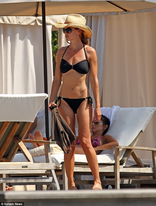 Fighting fit: Hilary Swank stands proud in a skimpy black bikini, spotted soaking up the sun while on holiday in the stunning Hawaiian island of Kauai yesterday