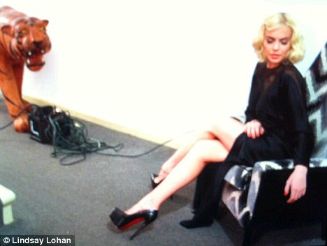 Check me out: Lindsay Lohan poses in the style of Marilyn Monroe and tweets the picture to her fans