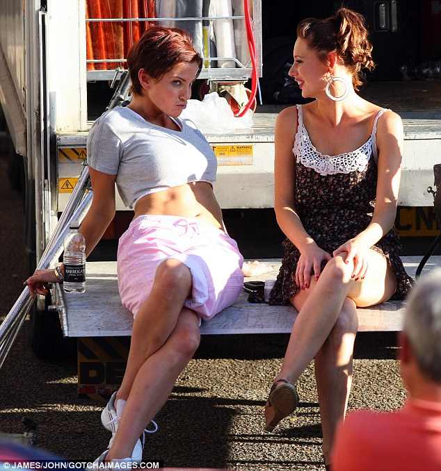 Messing around: Harding and Shirley have a girlie chat and a joke on one of the location vans during a break in filming