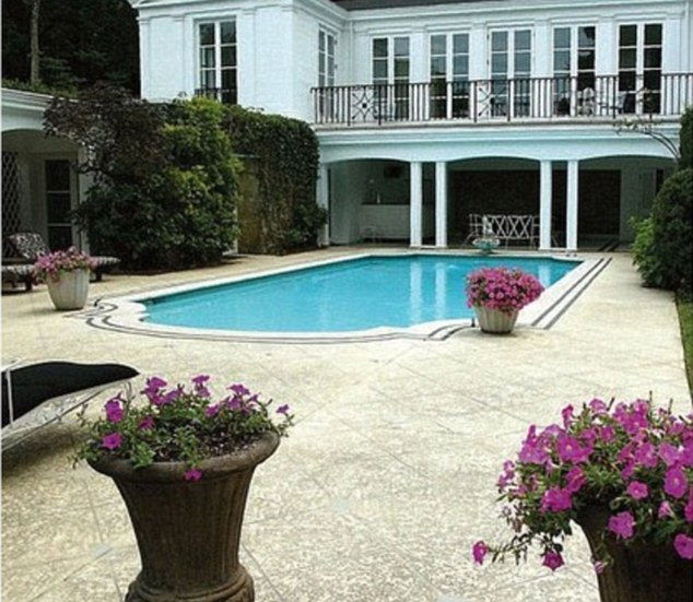 The house inside the house: The prime piece of property also boats a two-story pool house