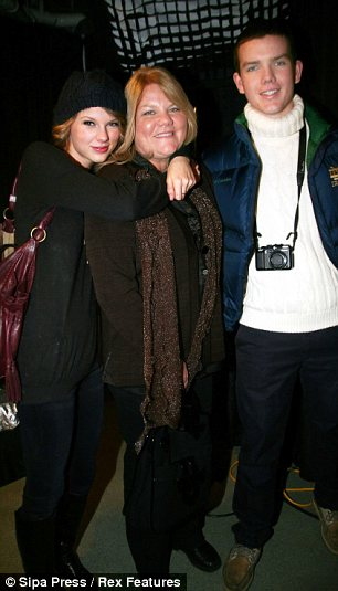 Happy family: Taylor seen with her mother Andrea and her brother Austin