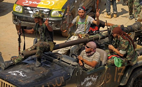 See you in Tripoli: Libyan rebels gather at the Bab al-Aziziya compound