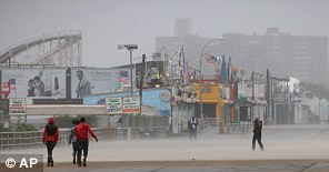 Driving wind and rain lash the Coney Island boardwalk in New York as Irene came closer to the area Sunday