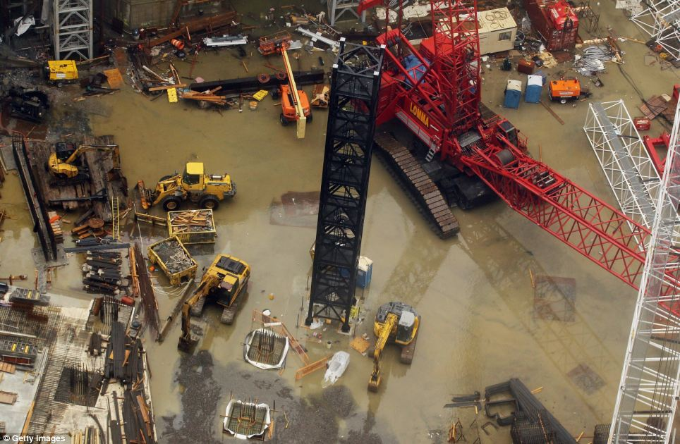 Underwater: Rainwater is seen collected beneath machinery at the World Trade Center yesterday