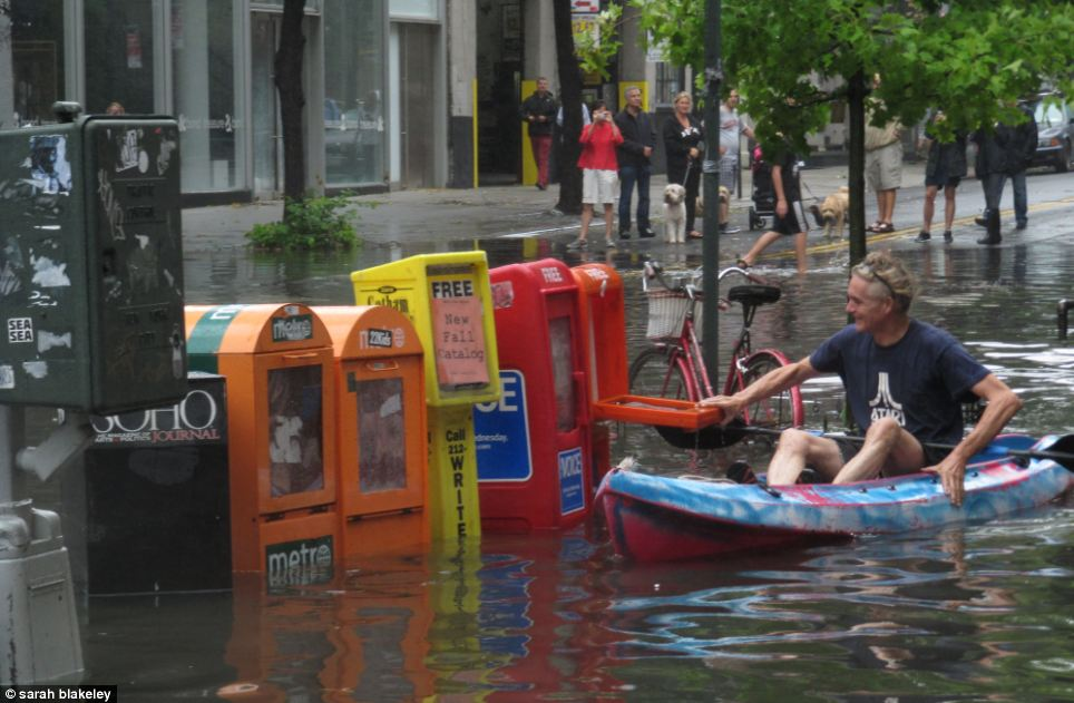 What's news? A man canoes to try get a newspaper in Soho on West Broadway in lower Manhattan