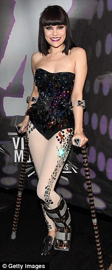 Still on crutches: Jessie J broke her foot falling off stage 11 weeks ago, but that didn't stop the star from making a glittering appearance at last night's VMAs