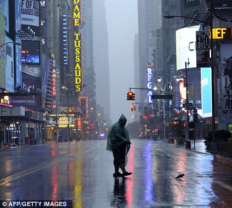 A lone tourist stands in the middle of Time Square