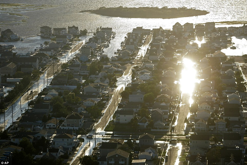 Destruction: The streets of Long Beach Island, New Jersey, are flooded after Irene moved through the area. It was just the third hurricane to come ashore in New Jersey in 200 years