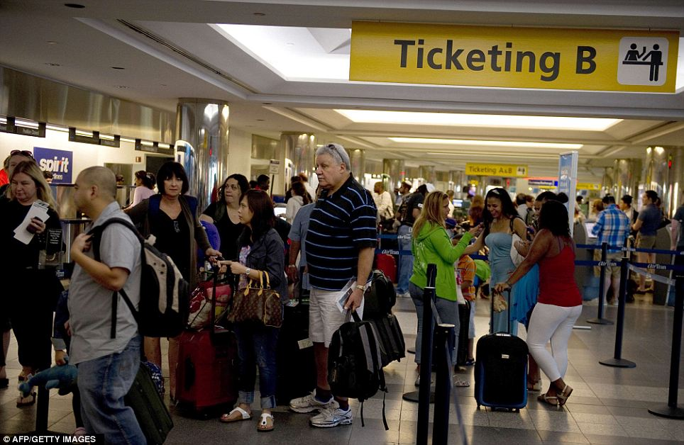 Frustration: Passengers stand in line at LaGuardia Airport in New York, as flights resumed today following Hurricane Irene