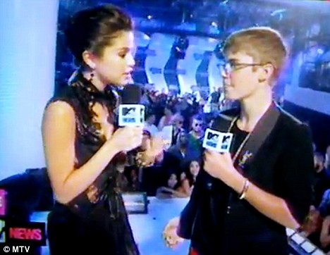 Professional: Selena interviewed her boyfriend as part of her co-hosting gig for the MVA pre-show for MTV