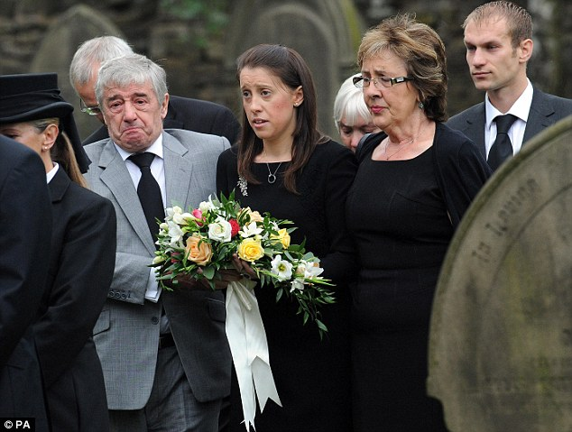 Devastated: Gemma Redmond attends the funeral of her husband Ian who was tragically killed on their honeymoon