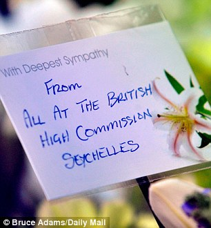 Tribute: A message at the funeral is left by the High Commission