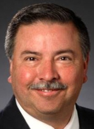 Wider the better: George Paz, chairman, CEO of Express Scripts, Inc (L) and Edward Mueller, CEO of Qwest Communications International Inc also rank high on Forbes' best paid list