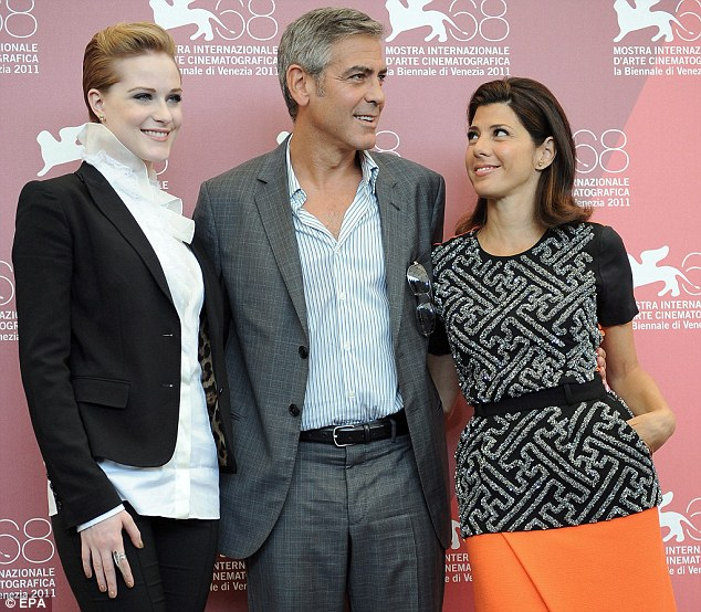George and his leading ladies: Clooney poses with his Ides Of March co-stars Evan Rachel Wood (left) and Marisa Tomei