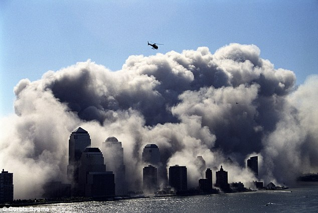 Deadly cloud: The dust generates from the collapse of the Twin Towers contained a mixture of cancer-causing agents, including lead from 50,000 pulverised computers and mercury from countless more light bulbs